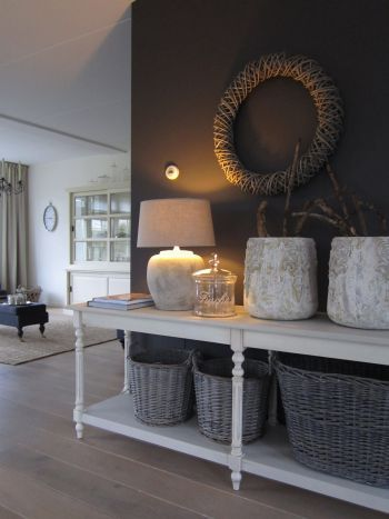 The baskets and round form of the stone vessels, softens the squareness of a contemporary room and adds texture