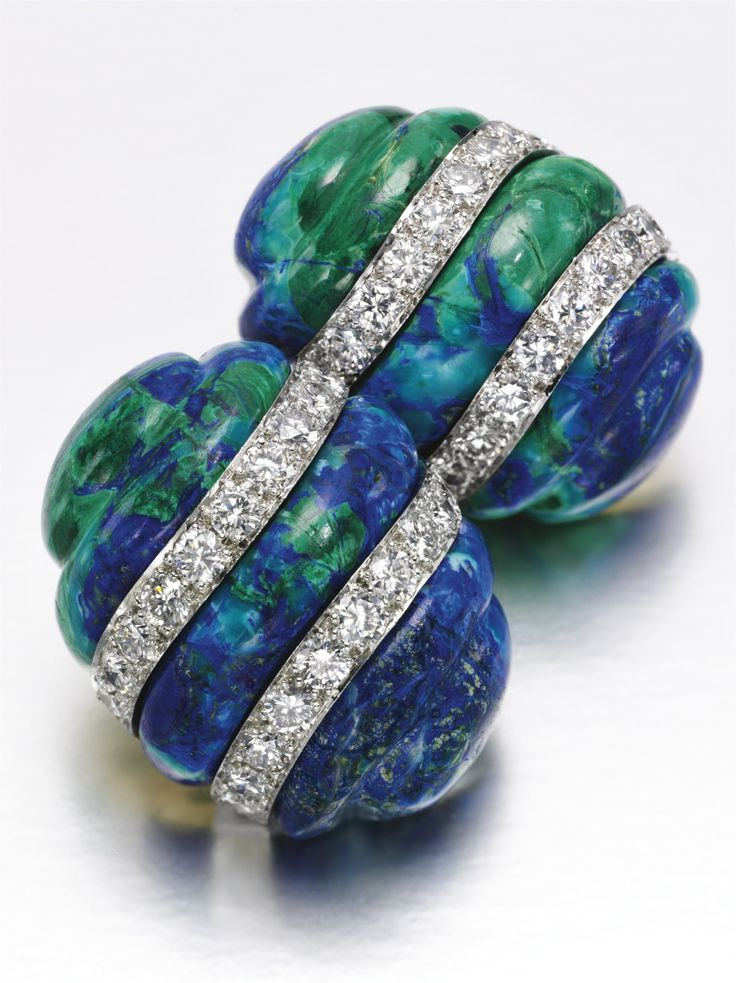 Pair of azurmalachite and diamond ear clips, David Webb Each designed as a carved azurmalachite inset with two bands of brilliant-cut diamonds, each signed Webb.azurmalachite, diamond, gold