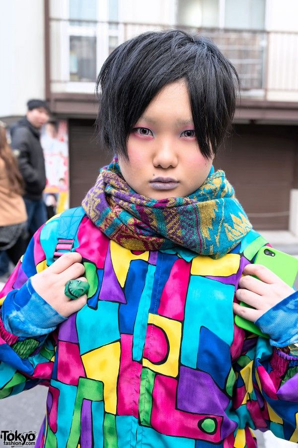 Gero is wearing a bold patterned top from a resale shop with ligher colored patt…