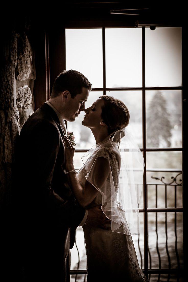 Window, dramatic lighting, Lace dress, Beautiful veil, Stone wall, Cambridge Mill, Cambridge, Ontario, Canada wedding photography experts | Anne Edgar Photography