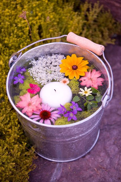 This is my favorite! For a casual surprise, pick colorful flowers and let float them in a can of water. Add a candle too and a few drop of favorite essence if appreciated.