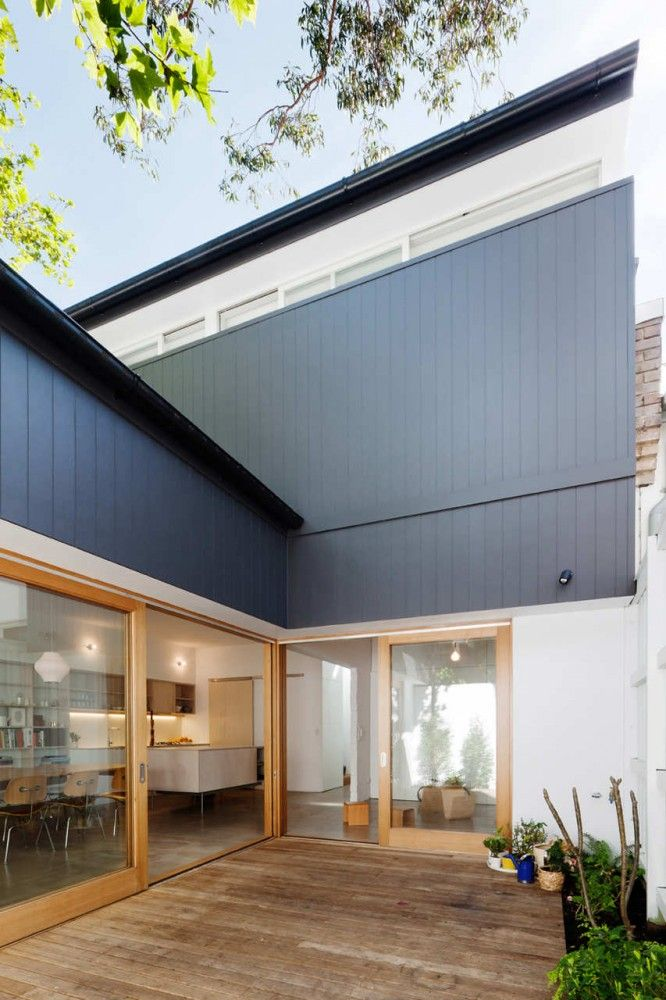 Vertical cladding and high, set in windows that sit flush with internal joinery (House Eadie / Tribe Studio Architects)