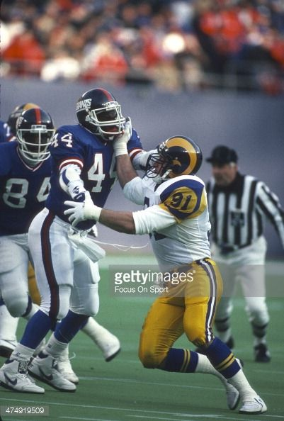 Kevin Greene of the Los Angeles Rams in action against Maurice Carthon of the New York Giants during the NFC Divisional Playoff January 7 1990 at The...