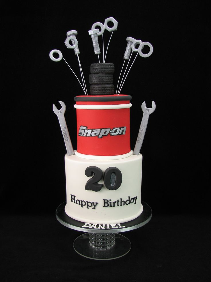 Snap On Tools Cake. Chocolate cake with milk chocolate ganache and covered in red and white fondant. Spanners, nuts, bolts and washers and tyres are hand made from fondant.