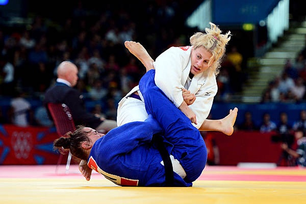 American Kayla Harrison (white) competes against Hungary's Abigel Joo (blue) during the women's 78kg elimination round. Harrison went on to win gold in the event