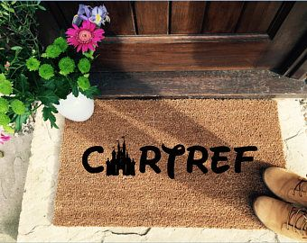 The ultimate door mat for Welsh Disney lovers.  Let everyone know they are entering a Disney household with this beautiful hand painted entrance mat!  Get yours - https://www.etsy.com/uk/listing/591195419/welsh-disney-welcome-mat-disney-home?ref=shop_home_active_16