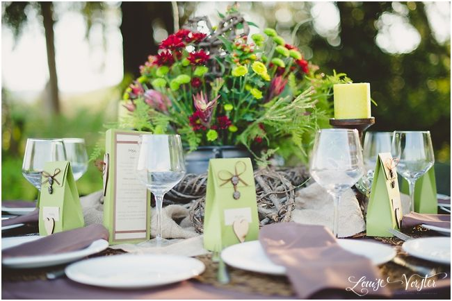 A different view of the table with the flower center pieces.
