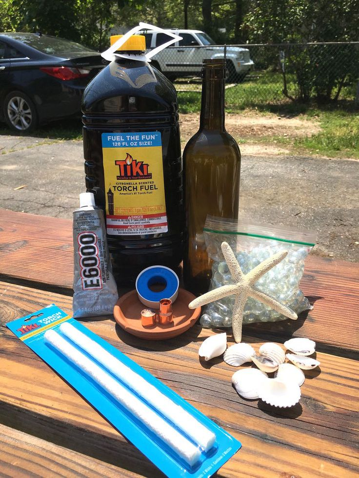 She fills a wine bottle with marbles, places it on her table, and we are SO trying this in our backyard!