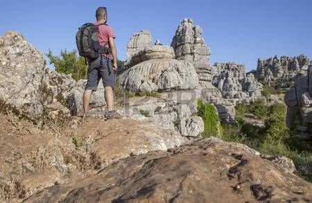 Man staring on rocky hill at Torcal de Antequera, Malaga, Spain