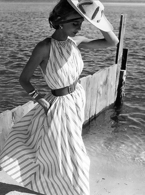 Helen Beatty in Claire McCardell's tent dress made of a Hope Stillman satin-striped cotton, photo by Herman Landshoff, Oak Beach, New York, Mademoiselle, 1951.
