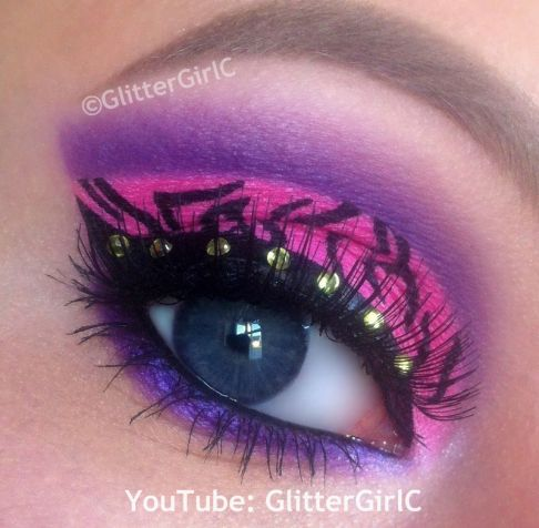 Wild pink, purple and black green eye art accented with crystals inspired by Monster High series Clawdeen Wolf by GlitterGirlC | Makeup by Cecilie A.