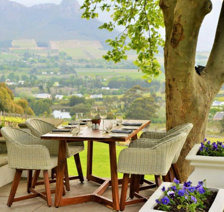 It's hard to imagine a more perfect setting for enjoying an alfresco meal than Le Petite Ferme in Franschhoek. The views from the terrace of sweeping lawns