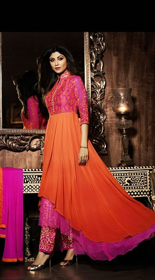 Perfect Orange And Pink Bollywood Parallel Pant With Asymmetrical Kameez 2BR703035  Modelled by Shilpa Shetty, Differentiate your look with this new and uniquely created designer parallel pant suit. The parallel pant suit in orange and pink color is crafted on poly georgette material and is decorated with resham and embroidery work. This outfit comes with embroidered bottom and matching dupatta.This unstitched outfit can be stitched in the maximum bust size of 42 inches.