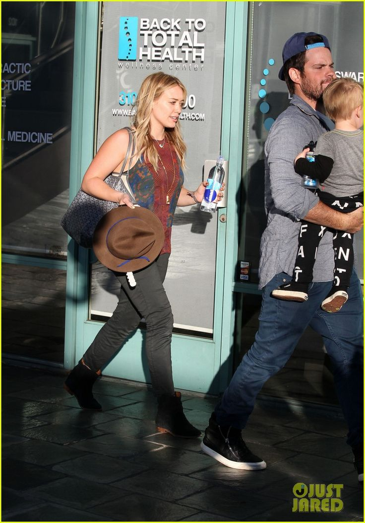 Hilary Duff and Mike Comrie take their son Luca to get his hair cut on November 27, 2013