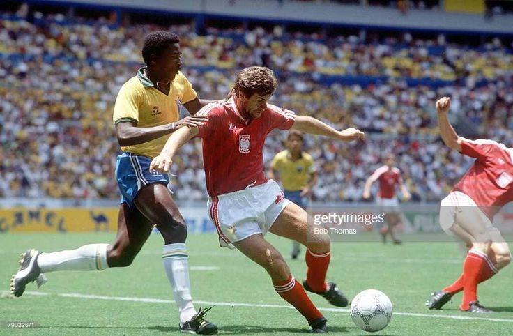 World Cup Finals, Second Phase, Guadalajara, Mexico, 16th June, 1986, Brazil 4 v Poland 0, Brazil's Josimar strongly challenges Poland's Wlodzimierz Smolarek for the ball