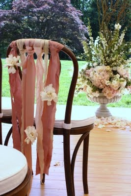 beautiful idea for decorating chairs for an outdoor party or wedding