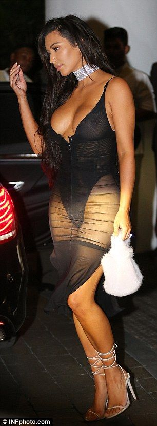 Eye-popping: Surely she drew plenty of attention as the black bodysuit underneath resembled lingerie