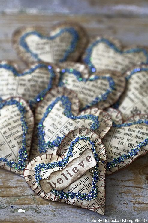 I love these from recycled books. They are warm and charming vintage decorations to remind us of the beauty and magic of Christmas! They would also be cute to incorporate it as an embellishment with the gift wrap and ribbon. Could serve 2 purposes : gift wrap decoration and a much loved ornament!!
