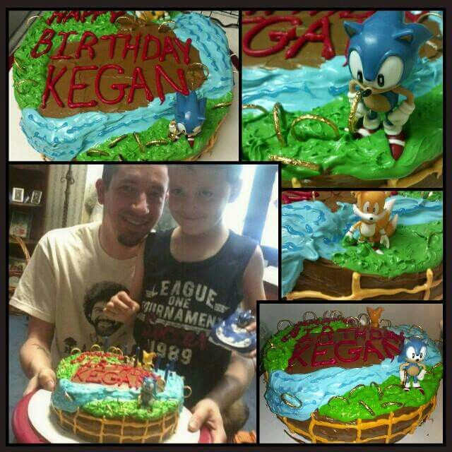 Kegan's 6th birthday. Chocolate sonic layer cake with chocolate icing in between layers and chocolate icing around the lower portion of the sides and vanilla icing tinted various colors to create a Sonic themed scene. Topped with Sonic figure and Gold plastic rings for Sonic to run around and collect!