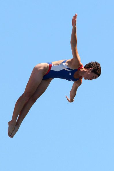 Ginger Huber of USA competes in the Women's 20m High Diving on day eleven of the 15th FINA World Championships at Moll de la Fusta on July 30, 2013 in Barcelona, Spain.