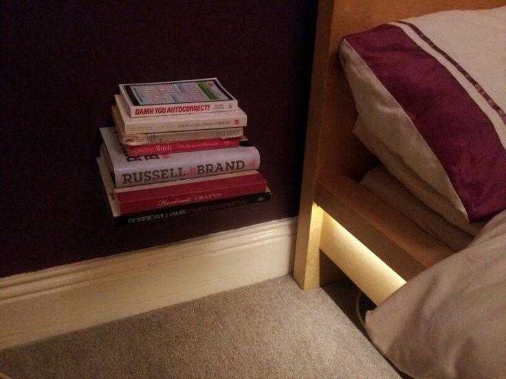 Floating bookshelves and under bed lighting