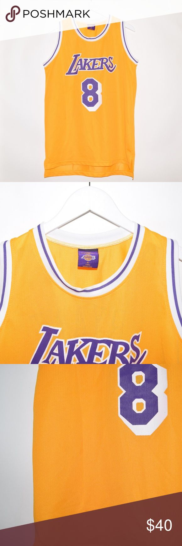 Vintage Links Marketing Kobe Bryant #8 Jersey Item name: Vintage Links Marketing Los Angeles Lakers Kobe Bryant #8 Basketball Jersey  Color: Gold / Purple  Condition: This is a pre-owned item. Aside from some small light stains on the left front of the jersey it is in great used condition with no rips, holes, etc. Comes from a smoke  free household.  Size: XL  Measurements:   Pit to Pit - 21.5 inches  Neckline to bottom - 32 inches Vintage Shirts