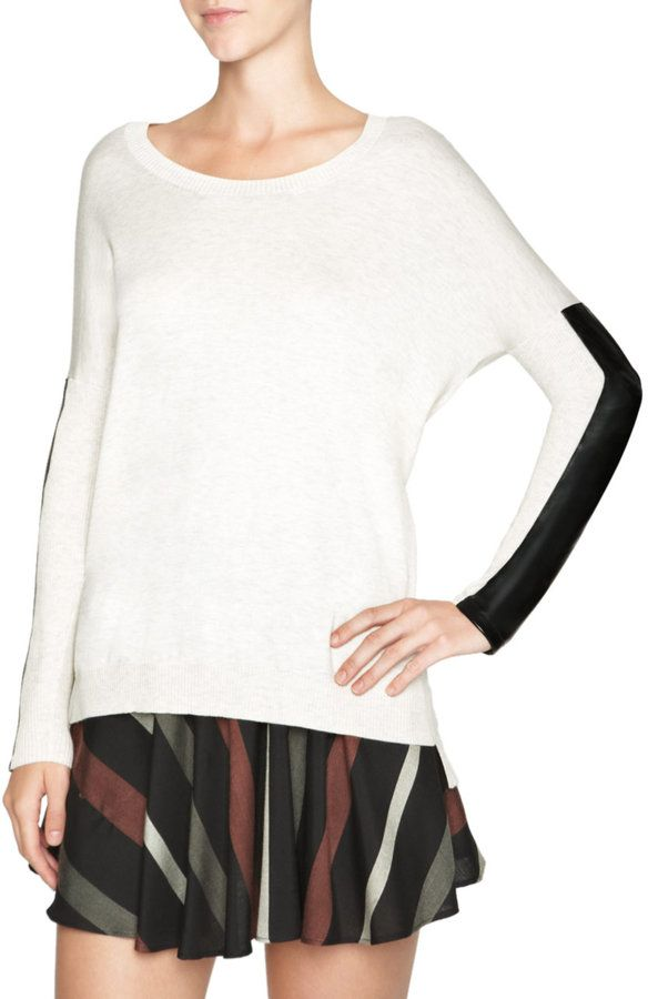 BCBG sweater with leather arms.  I saw this today... waiting for it to drop in price :)