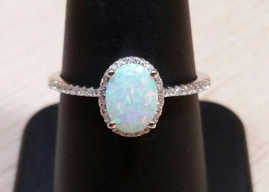 Only $25.99 + Shipping! FREE SHIPPING PROMO CODES BELOW! Packaged beautifully and shipped ready to gift! Sterling Silver Lab Opal Ring with Cubic Zirconia Accents Available in Sizes 4, 5, 6, 7, 8, 9, 10, 11, and 12 (we do not carry half-sizes in the ring)  FREE SHIPPING PROMO CODES: Free Priority Shipping on Domestic Orders over $60 with Promo Code: FREEPRIORITY60 Free First-Class Shipping on International Orders over $125 with Promo Code: FREEWORLD125  We package and ship most orders the…