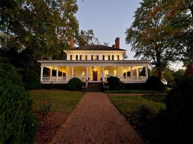 "Originally built in 1840 on a Georgia plantation known as Devil's Half Acre, outside of Macon, this  mansion was moved in 1864, at the height of the Civil War, ""17 miles away by ox cart,"" to its current location. Despite the hurried relocation, the house has survived another century and a half in remarkable condition, and is listed for $1.5M."
