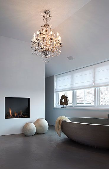 chandelier and pots ... Fireplace in a #bathroom in a farm The Netherlands (created by Baden Baden Interiors)                                                                                                                                                      More