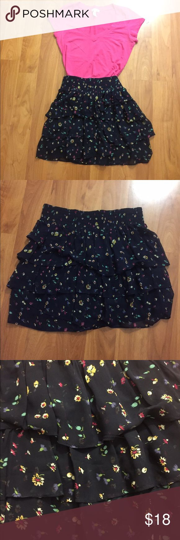 American eagle dark blue floral layered skirt This dark blue layered skirt with floral print is perfect to add with a colored tank or fitted tee to bring out the flowers. Pair makes it look like a dress. The pink fitted tee pictures here is on sale in my closet as well. American Eagle Outfitters Skirts