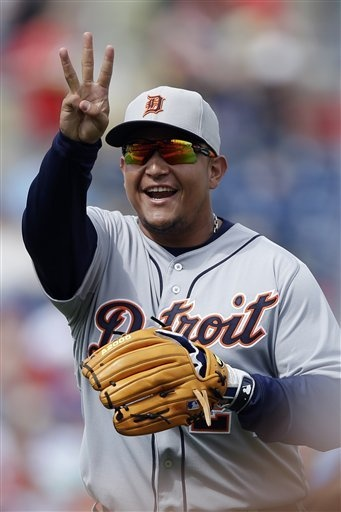 Detroit Tigers' Miguel Cabrera reacts as he runs to the Tigers' dugout after the first inning of a spring training exhibition baseball game against the Philadelphia Phillies, Monday, Feb. 25, 2013, in Clearwater, Fla.  (AP Photo/Matt Slocum)