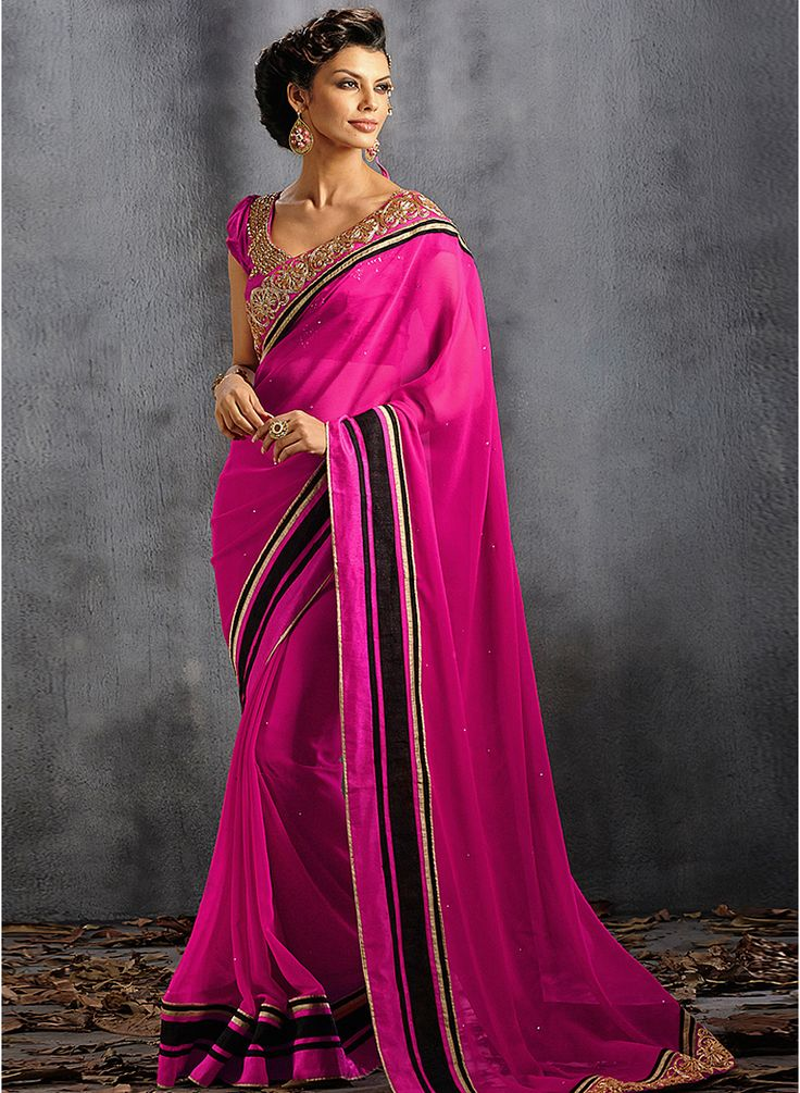 Look strikingly beautiful in this fuchsia colored embellished georgette saree #Pink #Saree #Party