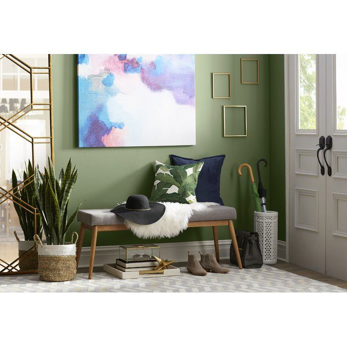 Add a touch of rustic whimsy to any space with this absolutely eye-catching faux sansevieria floor plant, featuring a simple plastic design and rounded wood planter. Set it in a midcentury modern-inspired living room to play with clean-lined furnishings and simple wood tables. For an eclectic, Southwestern-inspired look, arrange this with weathered wood benches and seats, then set out earthy ikat rugs, cowhide upholstered ottomans, and colorful patterned pillows around the room to tie the…