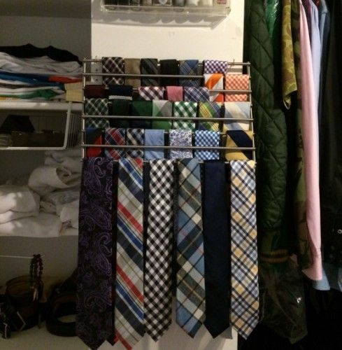 An easy IKEA hack is to use a Lamplig Trivet as a tie rack in a closet in a tiny apartment.