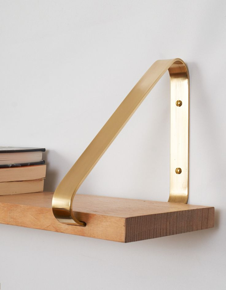 The wood and brass combo is a favorite of mine. The soft angles make this shelf elegant yet homey.