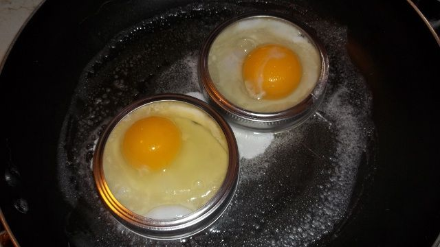 Repurpose mason jar rings into egg rings.   Spray the rings with cooking spray. Cook your egg. Remove the ring. Flip the egg and continue cooking. Perfect for a bagel or an english muffin.  source - http://lifehacker.com/5908035/repurpose-mason-jar-rings-into-egg-rings