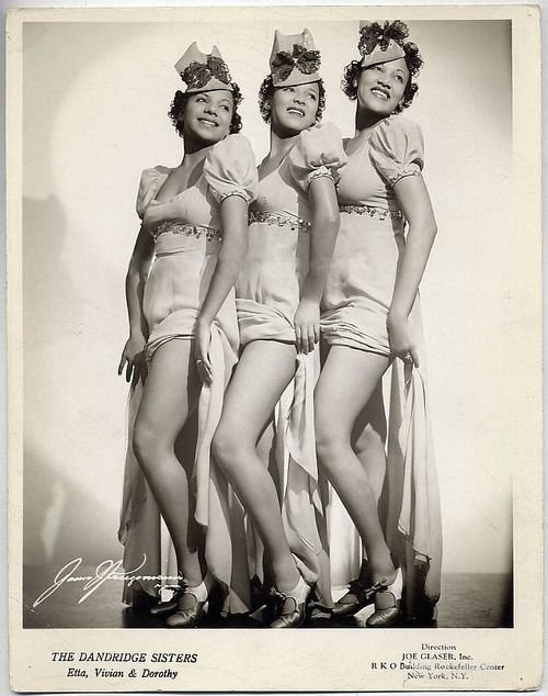 """The Dandridge Sisters appeared in many films in uncredited cameo roles. It was in 1938 when The Dandridge Sisters secured word at New York's famed Cotton Club. Dorothy Dandridge, Vivian Dandridge, and Etta Jones were a huge hit at the Cotton Club. They performed with famous acts like the Nicholas Brothers, Cab Calloway, and Bill """"Bojangles"""" Robinson. Their success at the Cotton Club led to a European tour. The Dandridge Sisters were a big hit in Europe, but the tour was cut short because of…"""