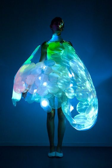 "'Philips Luminous Textiles is a company who focus on creating garments which have similar ""sensitive"" qualities as human skin. 'Bubelle', is a delicate 'bubble' dress illuminated by patterns that changed dependent on skin contact. 'Bubelle' was developed as part of the SKIN research project which looks into emotional sensing and explores technologies that are 'sensitive' rather than 'intelligent'."
