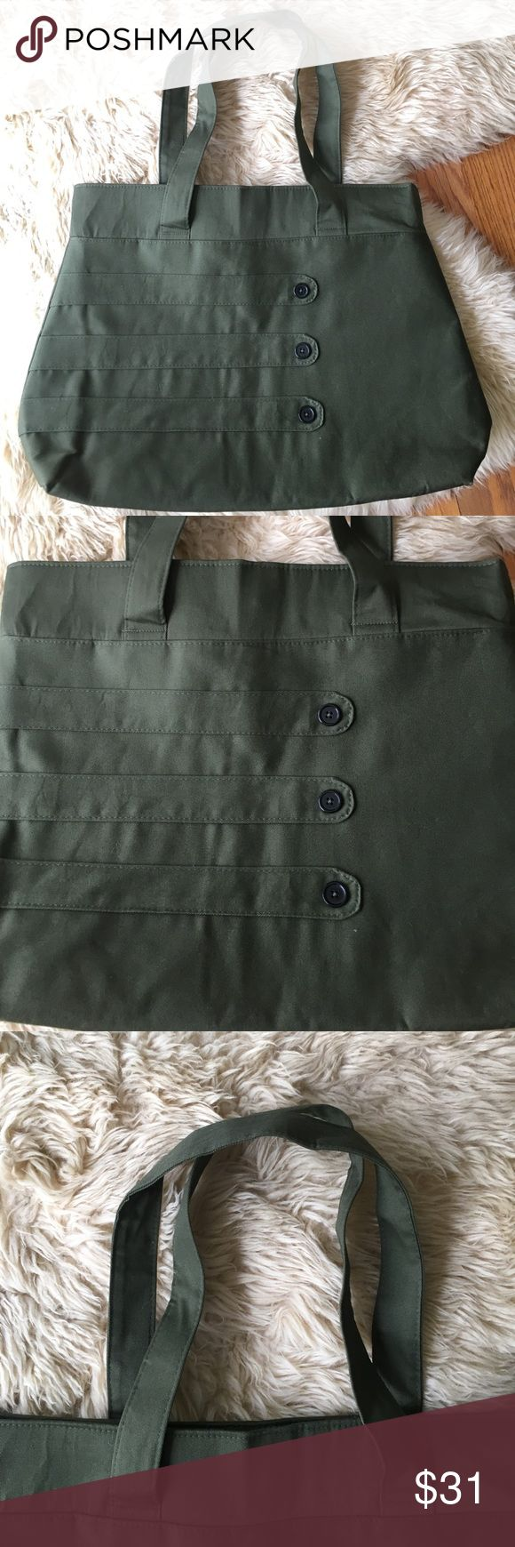 Whitney Jude Handmade Medium Tote Bag Whitney Jude Handmade Medium Tote Bag in Army green. Brand new without tags. Interior organizational pockets. Attractive interior fabric. Bundle three or more items and save 15% off! Whitney Jude Bags Totes