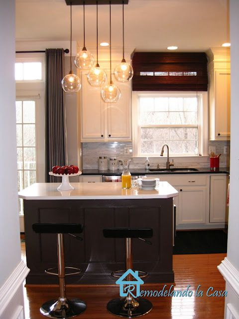 I want this light fixture! And I want white cabinets with all that wonderful molding!