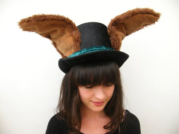 Join the Mad Hatters tea party with this incredible top hat with furry wired ears. Bend the fluffy brown ears into any desired shape. They are