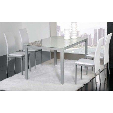 Conjunto de mesa con cuatro sillas para salón comedor o cocina. Es un conjunto de mesa metálica con tapa de cristal blanco o negro de 8mm de grosor y con círculo de acero termo-pegado  con estructura metálica con recubrimiento epoxi-poliester con cuatro sillas metálicas tapizadas.