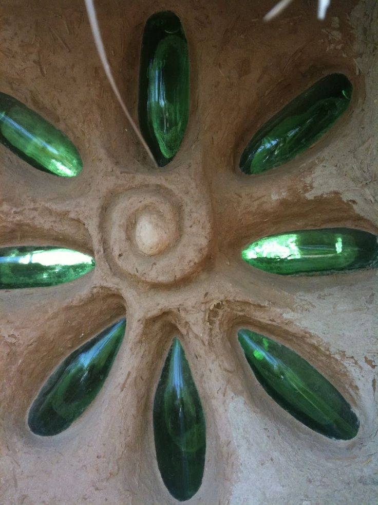 Recycled bottles become cob-style stained glass.