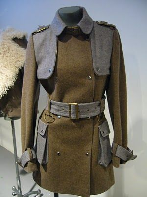 Jacket  Find an old WWII trench, and re-purpose into a dress?