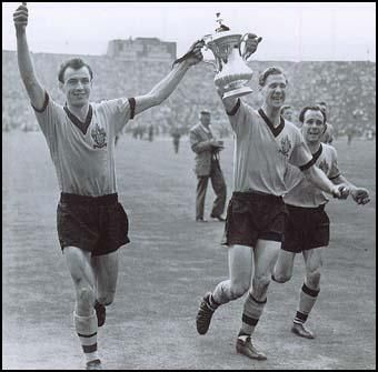 Eddie Clamp, Bill Slater and Norman Deeley celebrate the 1960 FA Cup win.