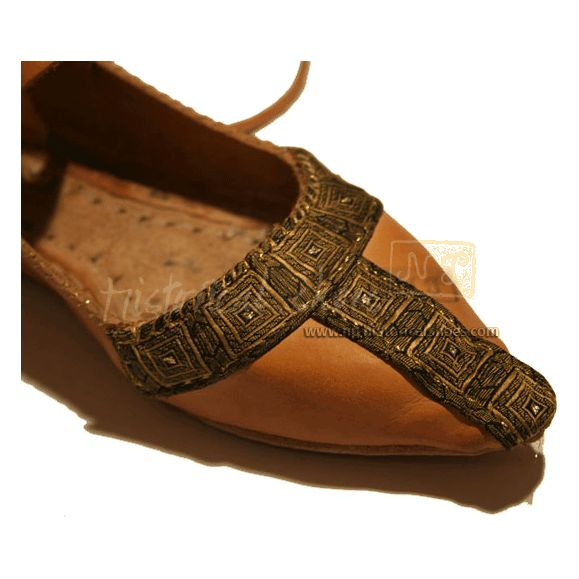 12. century.  This merchant (NP Historical Shoes, UK) sells the most AMAZING collection of handcrafted period shoes.  Check it out, world!