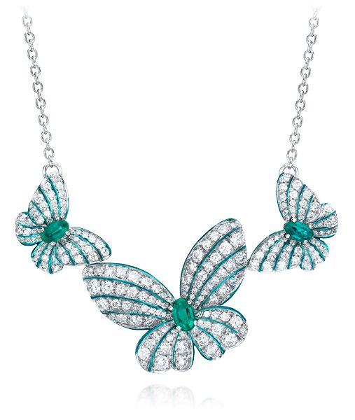 Cellini Jewelers Butterfly Necklace with Emeralds and Diamonds  This gorgeous pave butterfly pendant features 0.83 carats of oval cut emeralds and 2.21 carats of round brilliant diamonds. The delicacy and vibrancy of the butterfly is further enhanced with hand painted iridescent green enamel. Set in 18 karat white gold