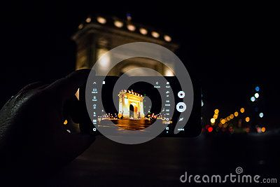 The triumph arch in Bucharest shot at night as seen through the lense of a mobile phone