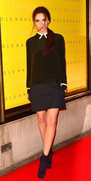 Victoria Beckham poses for photographers at the launch of new fashion line 'Victoria' at Harvey Nichols in London.
